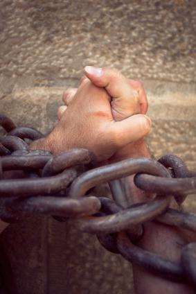 prisoner's hands clasped in prayer