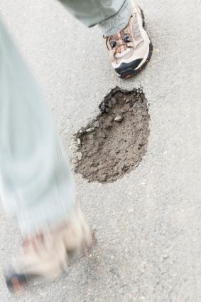 hole in sidewalk