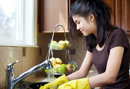 teen girl washing dishes