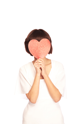 woman with heart in front of face