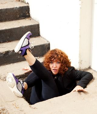 woman falling into hole