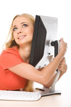 woman hugging computer