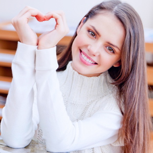 girl with hands in heart shape