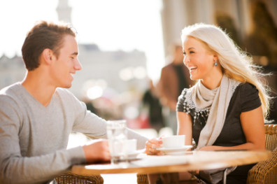 Beautiful couple sitting in a cafe.