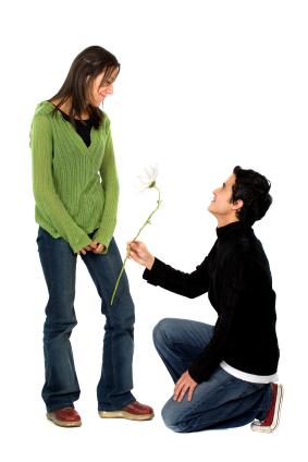 boy offering girl a flower