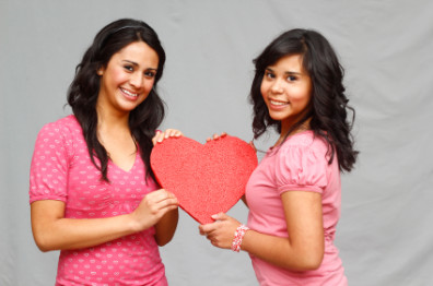 two_girls_holding_heart
