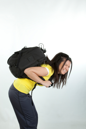woman carrying heavy backpack